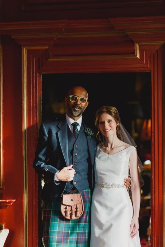 Groom and bride in silk zibeline dress