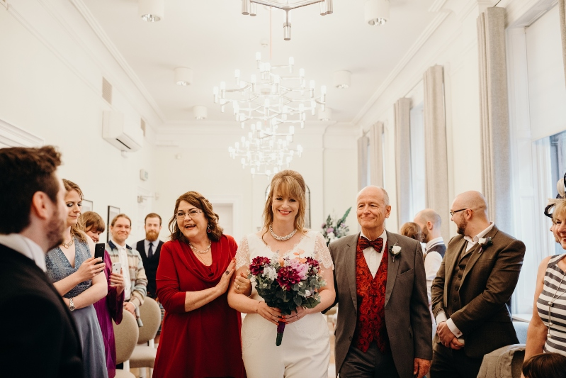 jumpsuit bride aisle