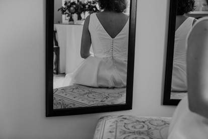 ballerina style bride getting dressed