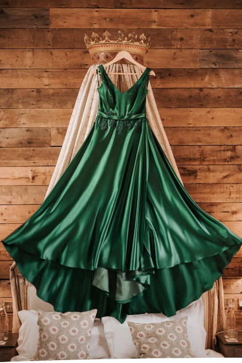 Green silk dress with satin belt and beaded lace