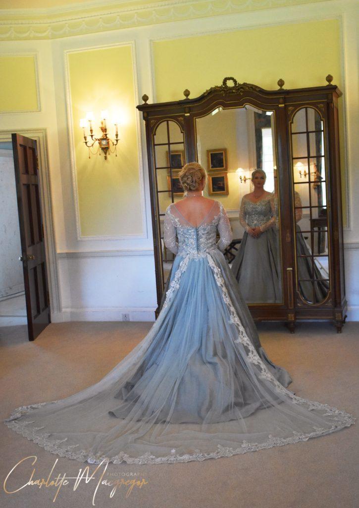 Soft blue wedding dress with train