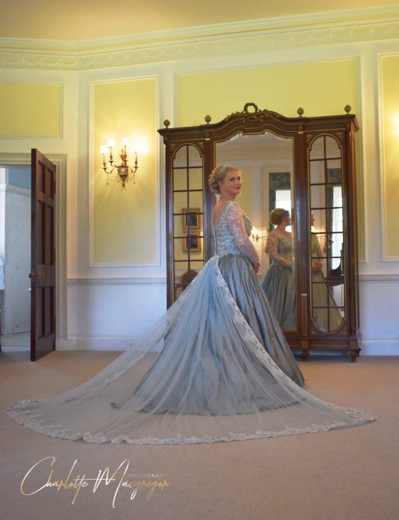 Soft blue wedding dress with train and embellishment