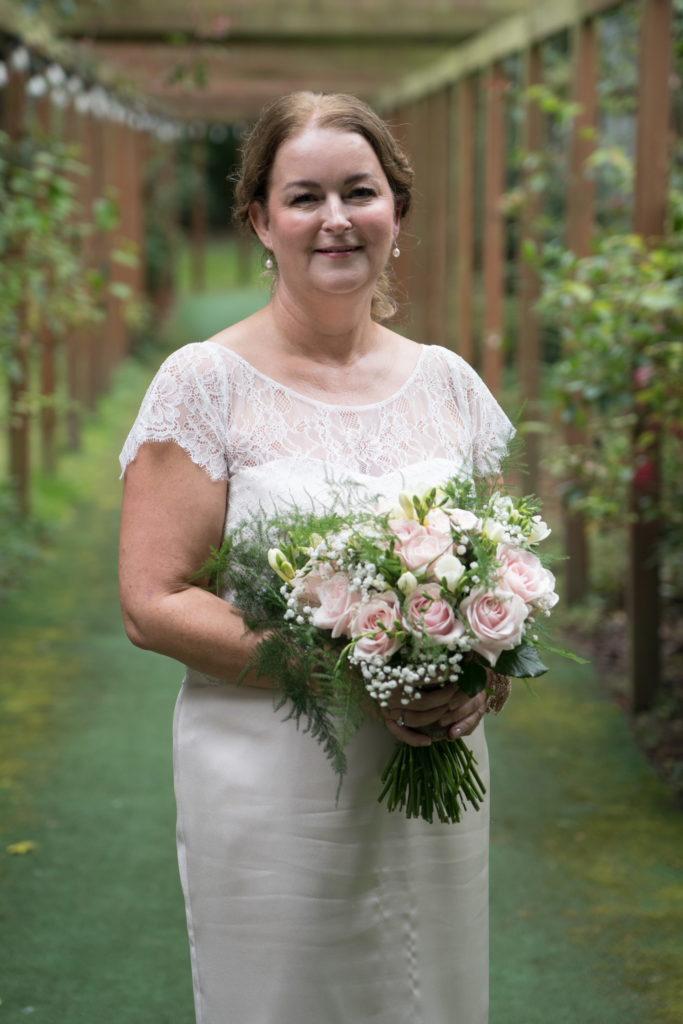 bridal portrait for bride in short champagne wedding dress