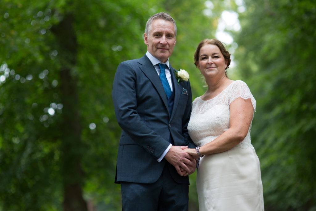 bride in short champagne wedding dress