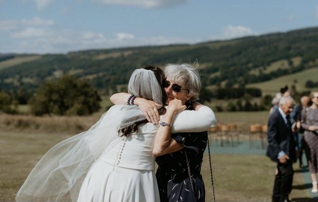 outdoors wedding ceremony hug